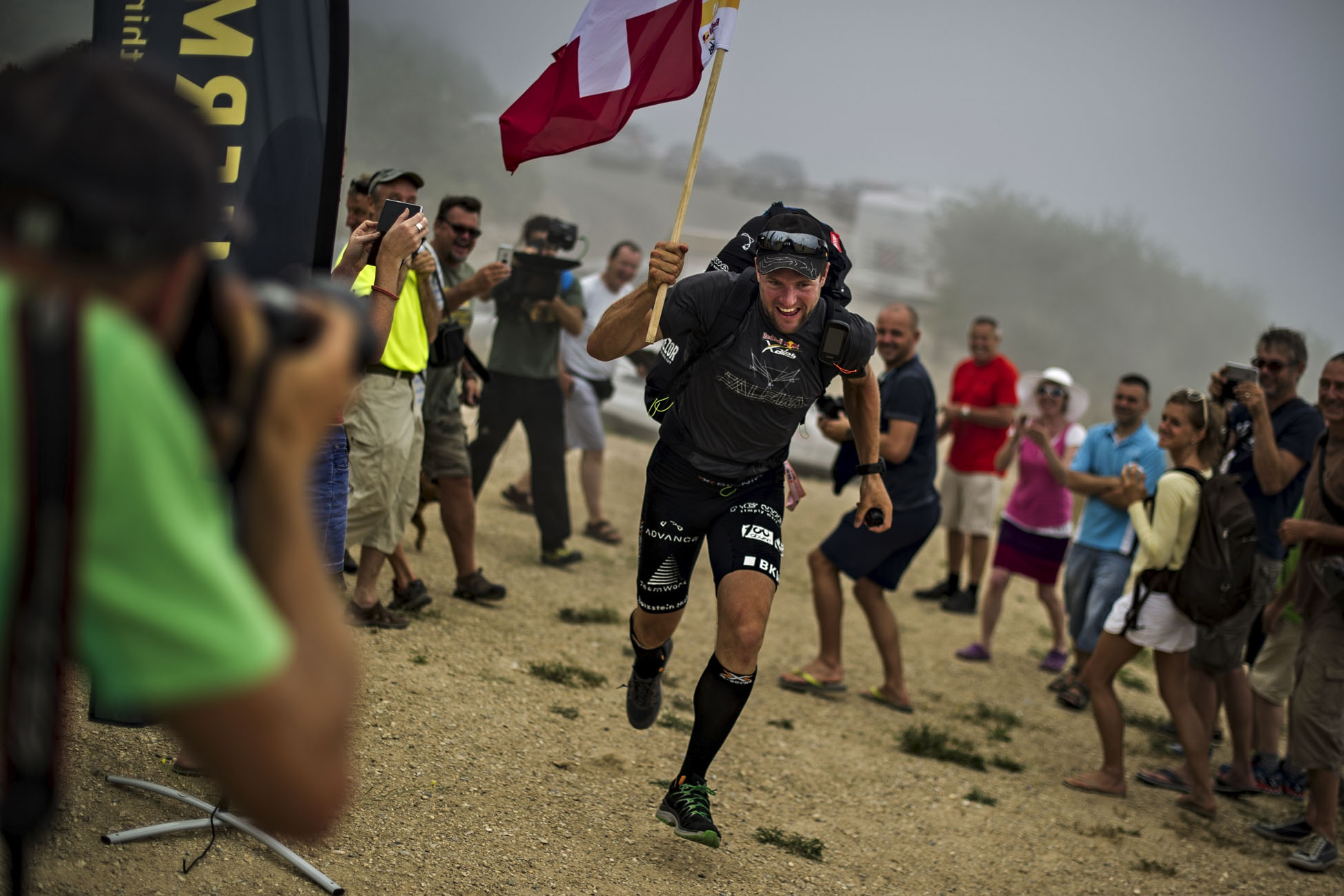 Chrigel Maurer of Switzerland arrives in Peille at the Red Bull X-Alps, France on July 13 2015. // Sebastian Marko/Red Bull Content Pool // P-20150728-00495 // Usage for editorial use only // Please go to www.redbullcontentpool.com for further information. //